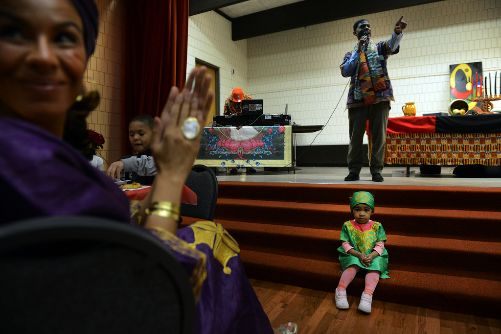. Iman Wilson, left, and her daughter Naila, 2, listen as Jeff Fard opens the Kwanzaa Celebration at the Zion Senior Center in Denver, CO, Saturday December, 29, 2012. The event highlighted the 150th anniversary of the Emancipation Proclamation with a theatrical performance depicting an enslaved family on Watch Night or Freedom\'s Eve, December 31, 1862. During the performance the family read the proclamation in anticipation of their coming freedom on New Years day, 1863. Craig F. Walker, The Denver Post