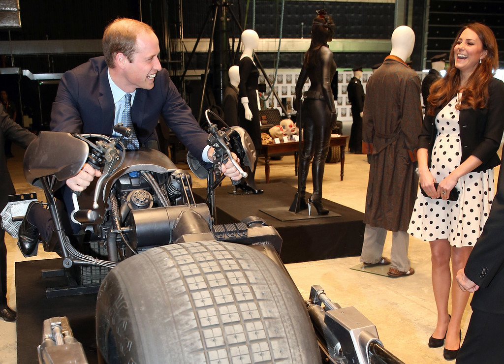 """. Britain\'s Kate the Duchess of Cambridge watches her husband Prince William as he sits on the \'Batpod\' during the inauguration of \""""Warner Bros. Studios Leavesden\"""" near Watford, approximately 18 miles north west of central London, Friday, April 26, 2013. (AP Photo/Chris Jackson, Pool)"""