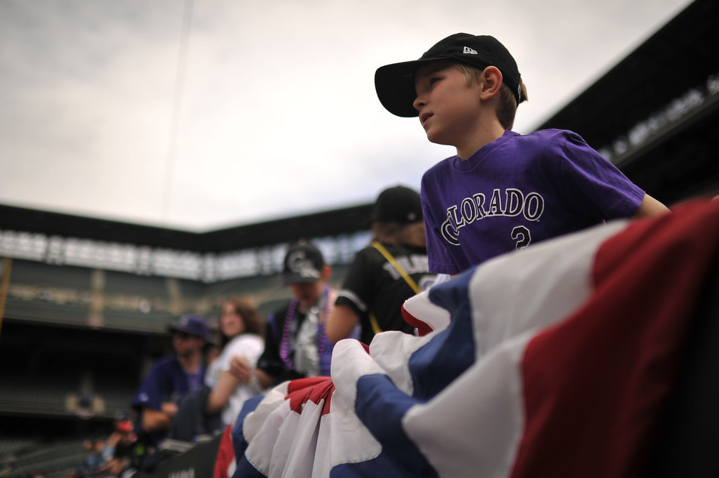 . Tyler Dame, 7, watches the players take batting practice before the start of the game. The Colorado Rockies took on the San Diego Padres on Opening Day at Coors Field in Denver, Colorado. (Photo by Hyoung Chang/The Denver Post)