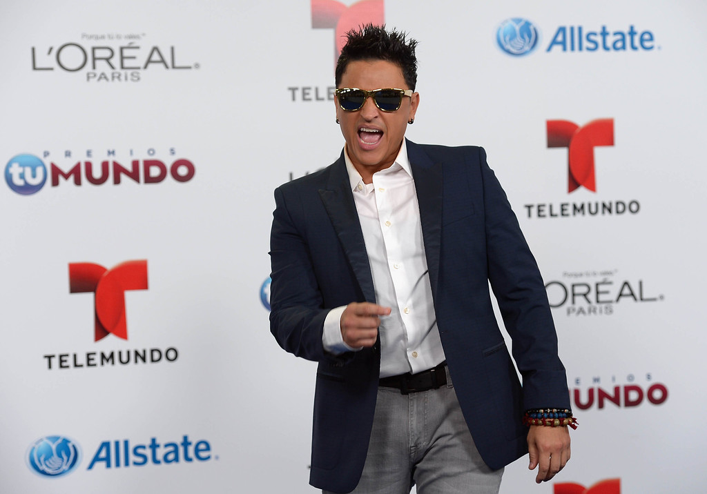 . MIAMI, FL - AUGUST 15:  Elvis Crespo arrives for Telemundo\'s Premios Tu Mundo Awards at American Airlines Arena on August 15, 2013 in Miami, Florida.  (Photo by Gustavo Caballero/Getty Images)