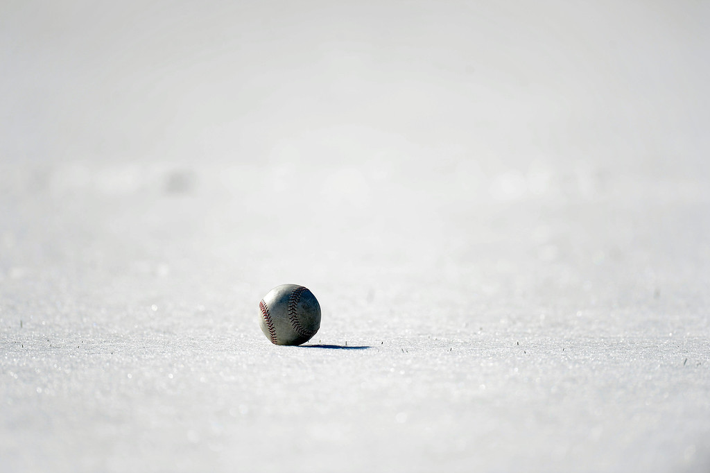 . SCOTTSDALE, AZ. - FEBRUARY 21: A baseball sits on a snow covered infield during the Colorado Rockies Spring Training February 21, 2013 in Scottsdale. A late night snow storm hit the area blanketing the fields forcing the team to limited activities. (Photo By John Leyba/The Denver Post)