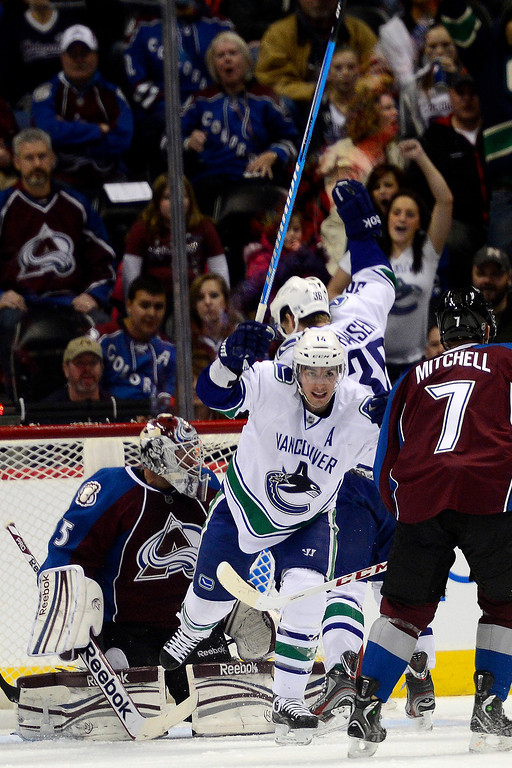 . DENVER, CO - MARCH 24: Alex Burrows (14) of the Vancouver Canucks celebrates his 1-0 goal against the Colorado Avalanche during the first period of action. Colorado Avalanche versus the Vancouver Canucks at the Pepsi Center. (Photo by AAron Ontiveroz/The Denver Post)