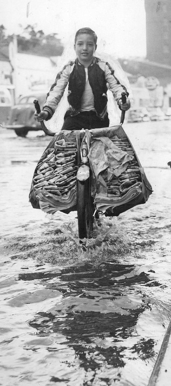 . In Spite of the storm, Carrier Maurice Nugent, 12, delivers the Denver Post. June 17, 1950. (Photo by Ira Gay Sealy/The Denver Post Archive)