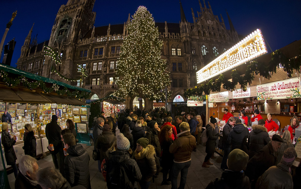 . People are enjoying the colorful stalls and the glittering lights at the Munich Christmas Market on Marienplatz at November 27, 2013 in Munich, Germany.  (Photo by Joerg Koch/Getty Images)