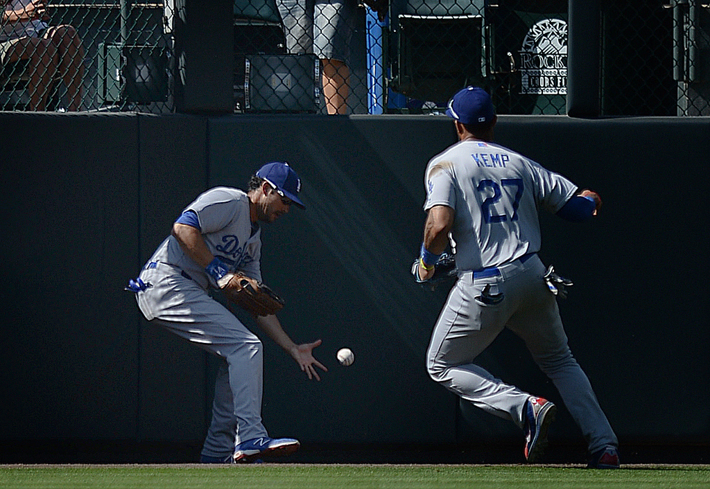 . DENVER, CO - JULY 5:  Charlie Culberson hit a triple to center field in the sixth inning. Andre Ethier, left, and Matt Kemp, right, tracked down the ball. The Colorado Rockies defeated the Los Angeles Dodgers 8-7 at Coors Field Saturday afternoon, July 5, 2014.  Photo by Karl Gehring/The Denver Post