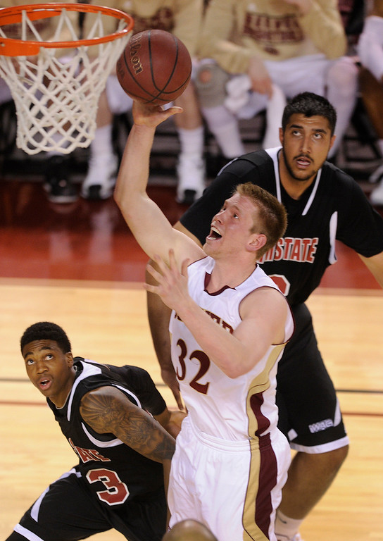 . DENVER, CO. - MARCH 2: Denver guard Chase Hallam (32) made a cut to the basket in the second half. The University of Denver men\'s basketball team defeated New Mexico State 66-60 Saturday evening, March 2, 2013 at Magness Arena. (Photo By Karl Gehring/The Denver Post)