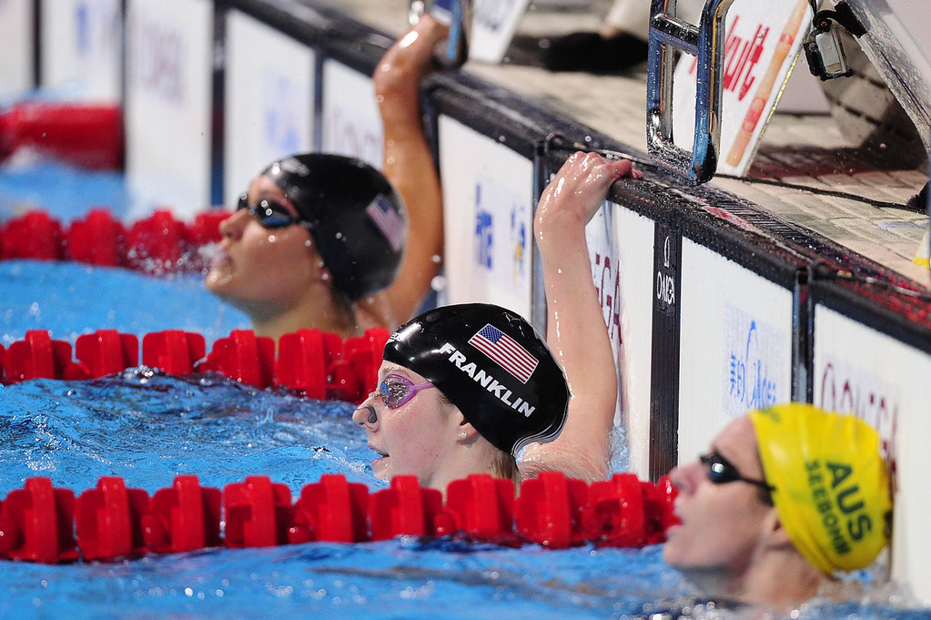 . Winner US swimmer Missy Franklin (C) and second-placed Australia\'s Emily Seebohm (R) react at the end of the final of the women\'s 100-metre backstroke swimming event in the FINA World Championships at Palau Sant Jordi in Barcelona on July 30, 2013.  JOSEP LAGO/AFP/Getty Images