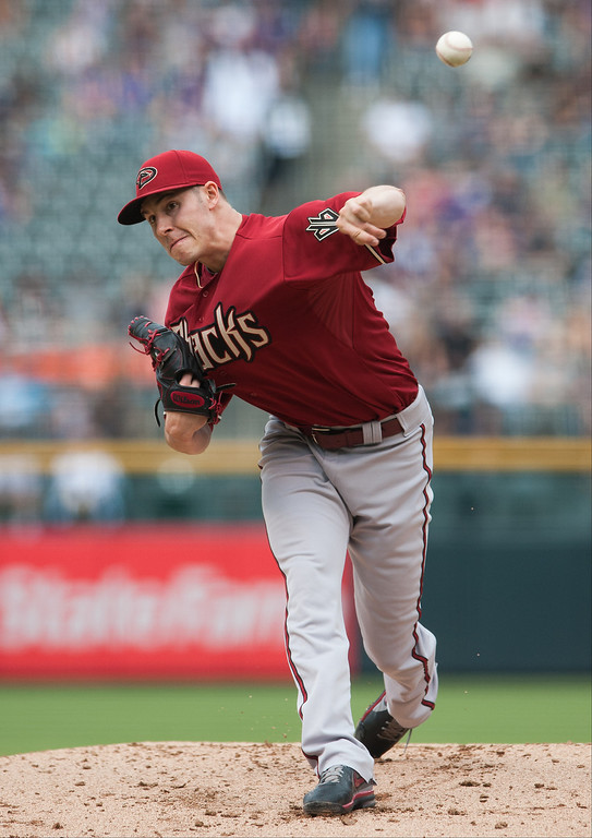 . Patrick Corbin #46 of the Arizona Diamondbacks pitches in the first inning of a game against the Colorado Rockies at Coors Field on September 22, 2013 in Denver, Colorado.  (Photo by Dustin Bradford/Getty Images)
