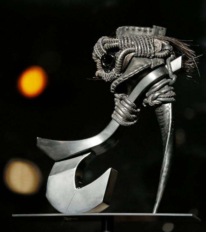 """. Masaya Kushino\'s \""""Storm Horse\"""" shoe, which features strands of a horse\'s mane, is displayed at the \""""Shoe Obsession\"""" exhibit at The Museum at the Fashion Institute of Technology Museum in New York. The exhibition, showing off 153 specimens, runs through April 13. (AP Photo/Kathy Willens)"""
