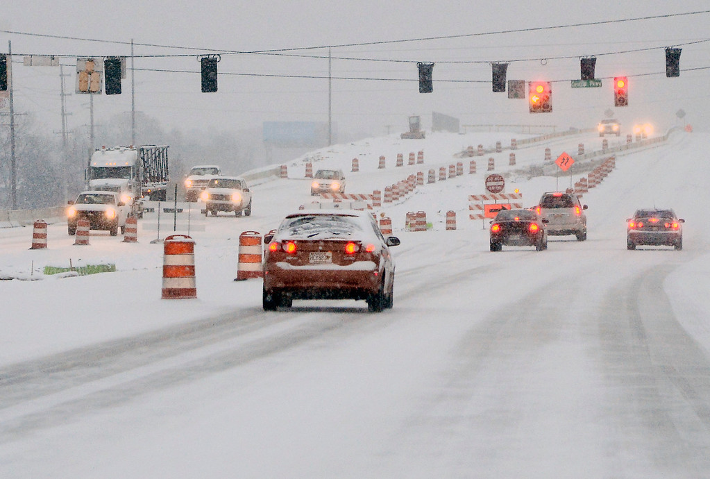 . Early morning commuters navigate icy roads in Decatur, Ala., after snow fell overnight Tuesday, Feb. 11, 2014. (AP Photo/The Decatur Daily, John Godbey)