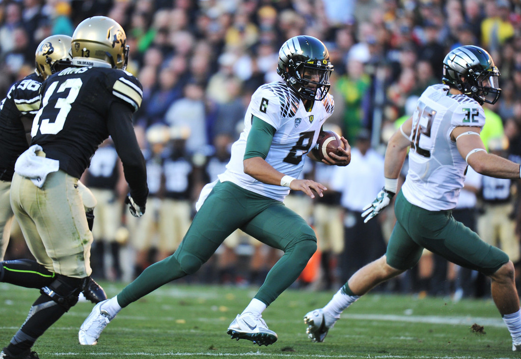 . BOULDER, CO - OCTOBER 05 : QB Marcus Mariota of University of Oregon (8) controls the ball against the University of Colorado defense in the 2nd quarter at Folsom Field. Boulder, Colorado. October 5, 2013. (Photo by Hyoung Chang/The Denver Post)