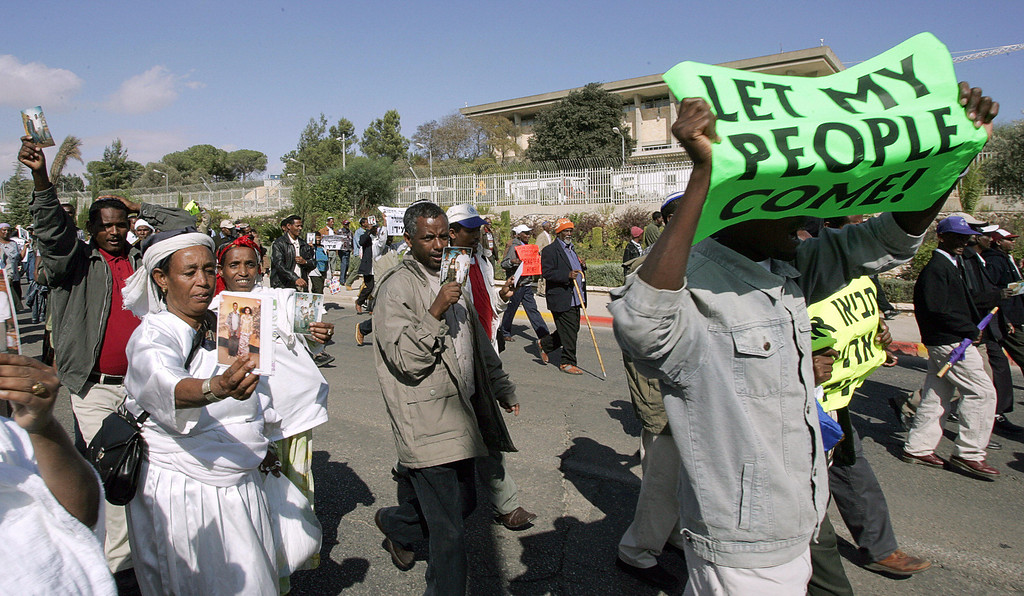 . JERUSALEM, -:  Ethiopian Jews march close to the Israeli prime minister offices in Jerusalem 30 October 2005, demanding action by the government in bringing over to Israel the rest of their families still at their homeland of Ethiopia. YOAV LEMMER/AFP/Getty Images