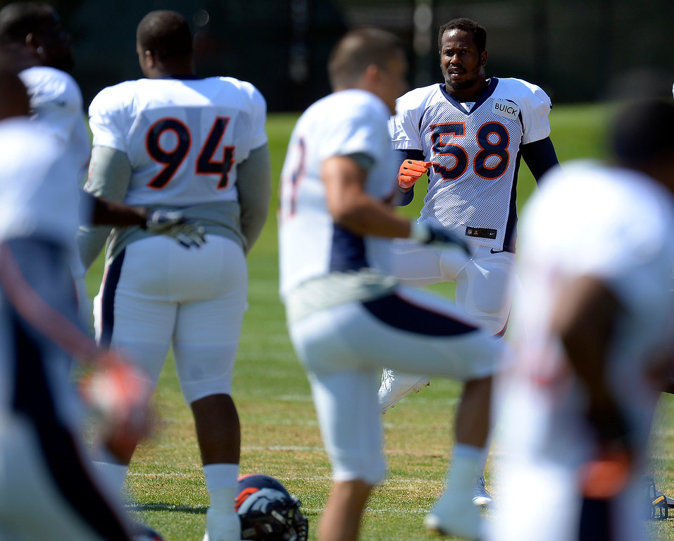 . Denver Broncos outside linebacker Von Miller (58) stretches during practice August 20, 2013 at Dove Valley. The discipline of the Broncos\' star linebacker are expected to continue Tuesday. (Photo by John Leyba/The Denver Post)