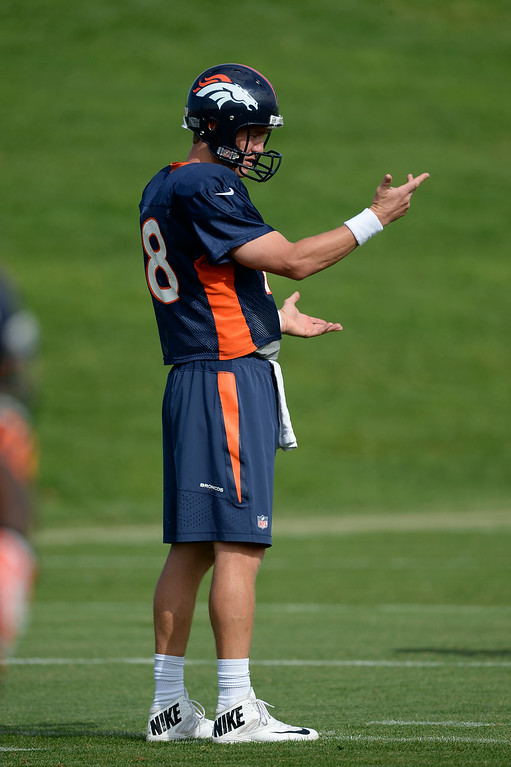 . Denver Broncos quarterback Peyton Manning (18) runs through drills on day 12 of the Denver Broncos 2014 training camp August 5, 2014 at Dove Valley. (Photo by John Leyba/The Denver Post)
