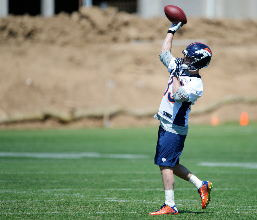 . Denver Broncos Wes Welker (83) throws a football in drills during OTAs June 12, 2014 at Dove Valley. (Photo by John Leyba/The Denver Post)
