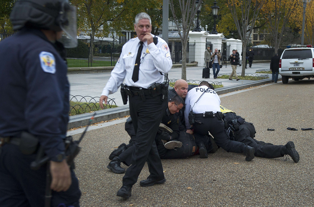 . A demonstrator, and supporter of the group Anonymous, is arrested by Uniformed Secret Service officers during a protest against corrupt governments and corporations in front of the White House in Washington, DC, November 5, 2013, as part of a Million Mask March of similar rallies around the world on Guy Fawkes Day.       AFP PHOTO / Jim WATSON/AFP/Getty Images