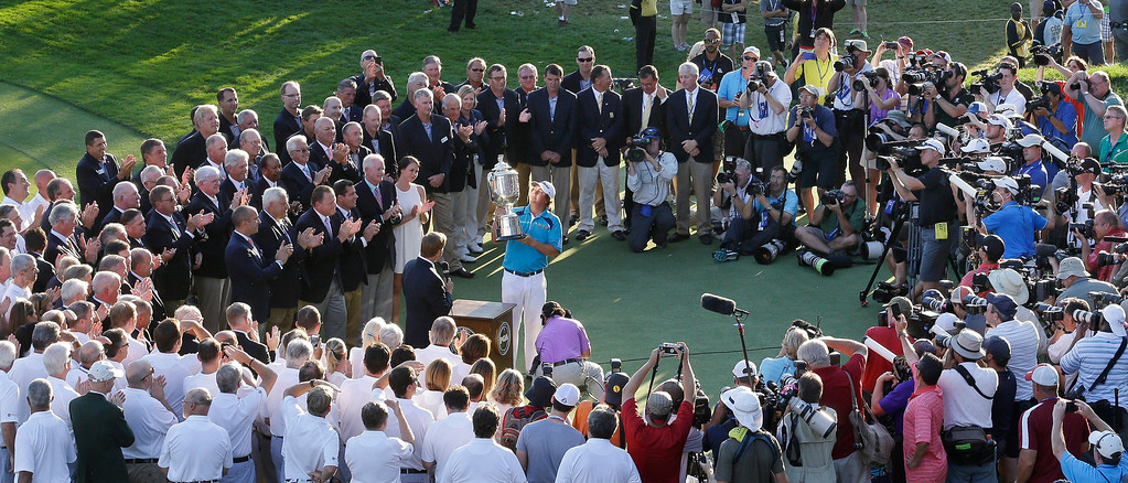 . Jason Dufner, at center, holds up the Wanamaker Trophy after winning the PGA Championship golf tournament at Oak Hill Country Club, Sunday, Aug. 11, 2013, in Pittsford, N.Y. (AP Photo/Patrick Semansky)