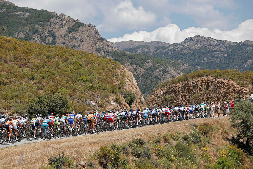 . The pack climbs during the third stage of the Tour de France cycling race over 145.5 kilometers (91 miles) with start in Ajaccio and finish in Calvi, Corsica island, France, Monday July 1, 2013. (AP Photo/Laurent Cipriani)