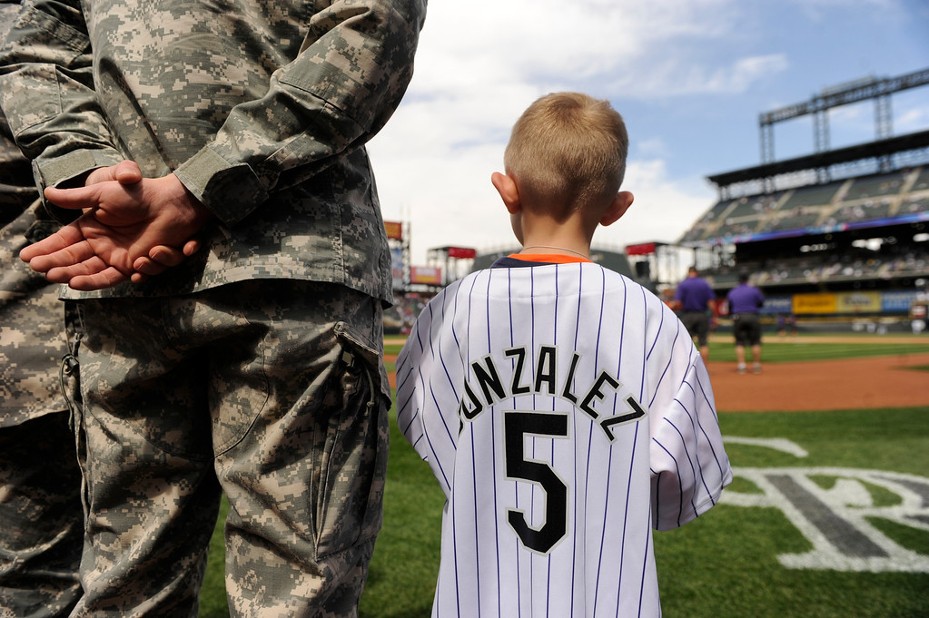 . Damian Rice, 5, takes a look at the field before the start of the Rockies game. (Photo by Karl Gehring/The Denver Post)