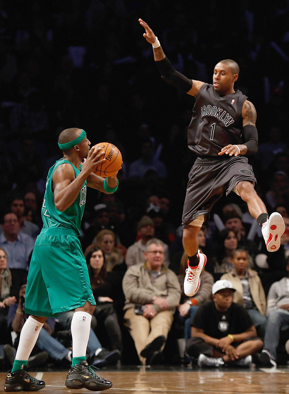 . NEW YORK, NY - DECEMBER 25:  Jason Terry #4 of the Boston Celtics looks to pass the ball against C.J. Watson #1 of the Brooklyn Nets at the Barclays Center on December 25, 2012 in the Brooklyn borough of New York City. The Boston Celtics defeated the Brooklyn Nets 93-76.  (Photo by Mike Stobe/Getty Images)