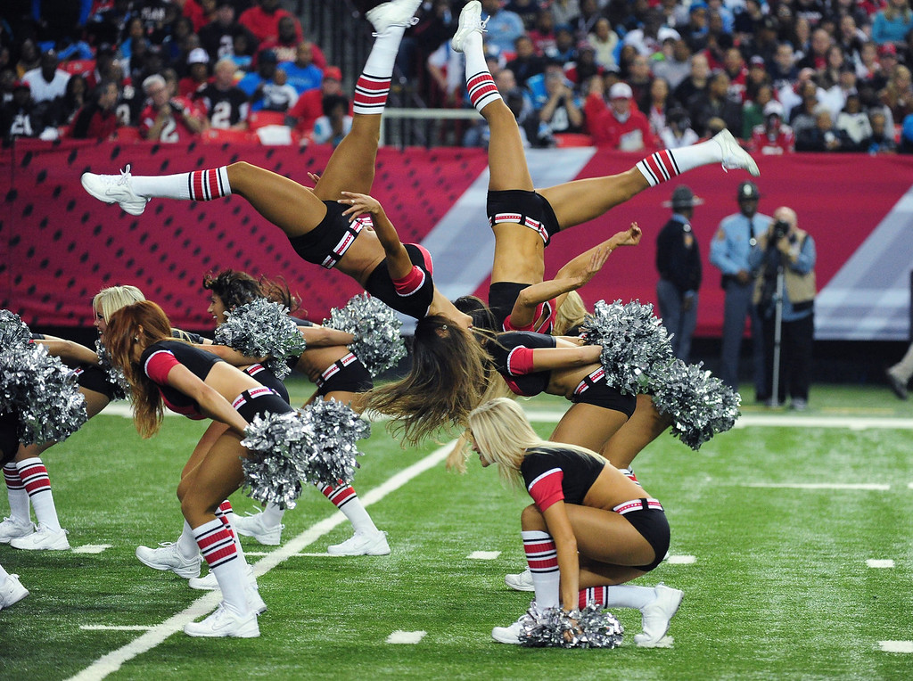 . Members of the Atlanta Falcons Cheerleaders perform during the game against the Carolina Panthers at the Georgia Dome on December 29, 2013 in Atlanta, Georgia. (Photo by Scott Cunningham/Getty Images)