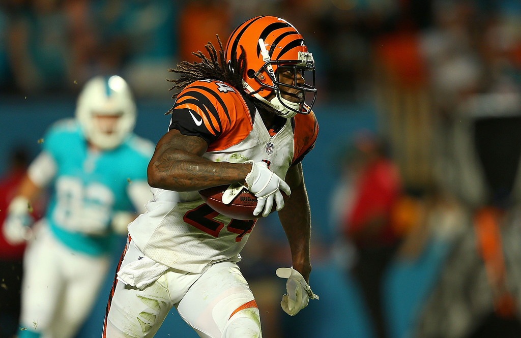 . MIAMI GARDENS, FL - OCTOBER 31:  Adam Jones #24 of the Cincinnati Bengals recovers a fumble during a game against the Miami Dolphins at Sun Life Stadium on October 31, 2013 in Miami Gardens, Florida.  (Photo by Mike Ehrmann/Getty Images)