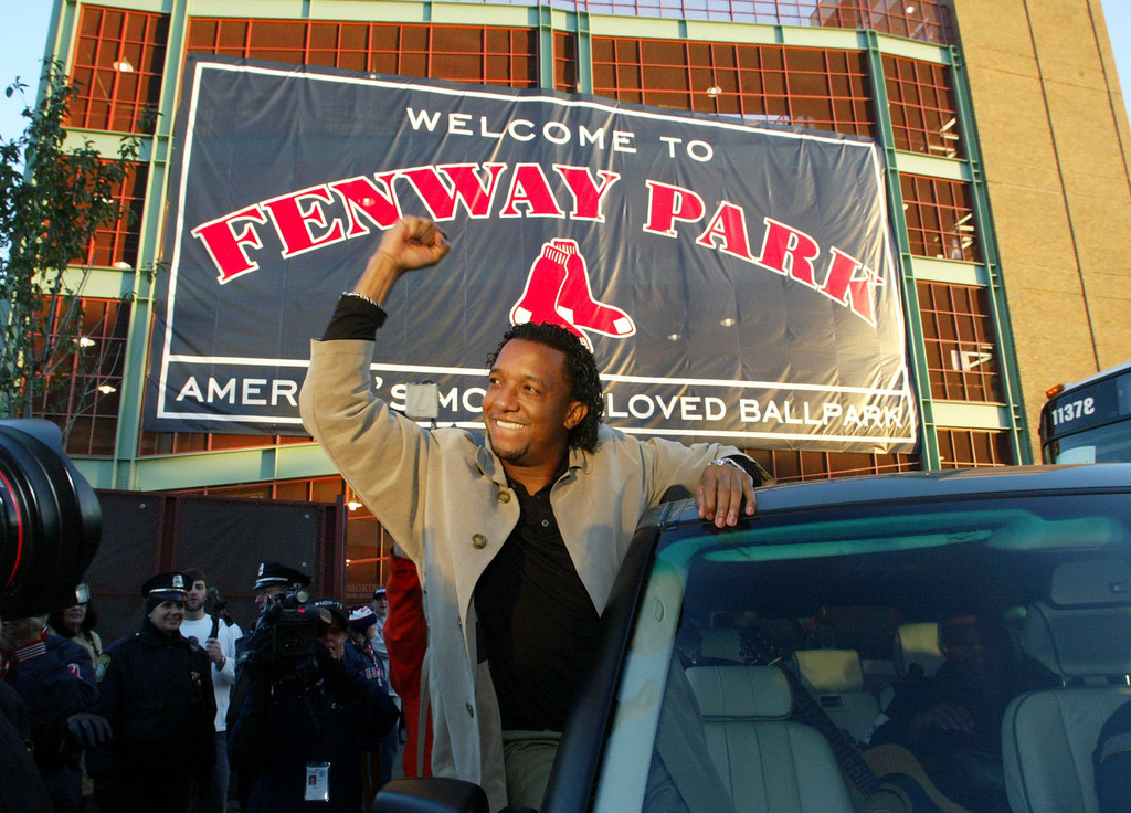 . A jubilant Pedro Martinez, of the Boston Red Sox,  acknowledges the crowd that gathered around Fenway Park  in Boston early Thursday morning Oct. 28, 2004. Martinez and the Boston Red Sox swept the St Louis Cardinals in four games to win their first World Series since 1918. (AP Photo/Bizuayehu Tesfaye)