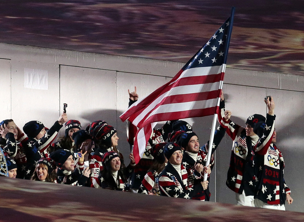 . Todd Lodwick of the United States carries his country flag as the team arrives during the opening ceremony of the 2014 Winter Olympics in Sochi, Russia, Friday, Feb. 7, 2014. (AP Photo/Ivan Sekretarev)