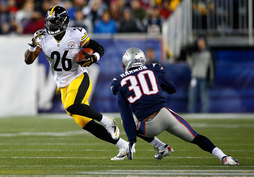 . LeVeon Bell #26 of the Pittsburgh Steelers runs with the ball by Duron Harmon #30 of the New England Patriots in the first quarter at Gillette Stadium on November 3, 2013 in Foxboro, Massachusetts.  (Photo by Jared Wickerham/Getty Images)