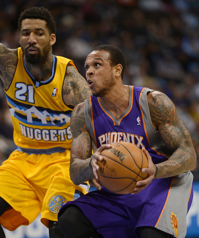 . Shannon Brown (26) of the Phoenix Suns drives to he basket  on Wilson Chandler April 17,  2013 at Pepsi Center. (Photo By John Leyba/The Denver Post)