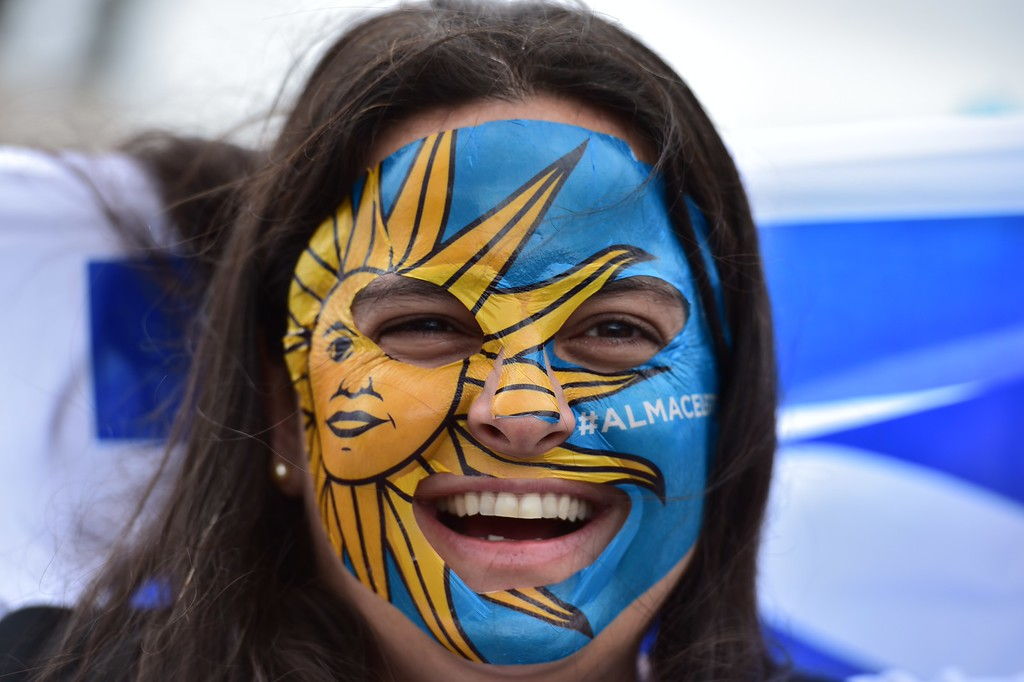 . Uruguay\'s fans cheer outside the Corinthians Arena Stadium on June 19, 2014 in Sao Paulo, prior to a Group D football match between Uruguay and England during the 2014 FIFA World Cup football tournament.     AFP PHOTO / NELSON ALMEIDA/AFP/Getty Images