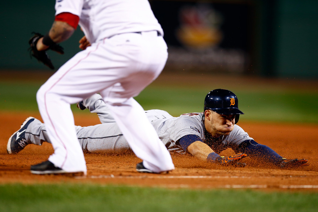 . BOSTON, MA - OCTOBER 19:  Jose Iglesias #1 of the Detroit Tigers slides back safe to first base following a pop fly ball in the third inning against the Boston Red Sox during Game Six of the American League Championship Series at Fenway Park on October 19, 2013 in Boston, Massachusetts.  (Photo by Jared Wickerham/Getty Images)