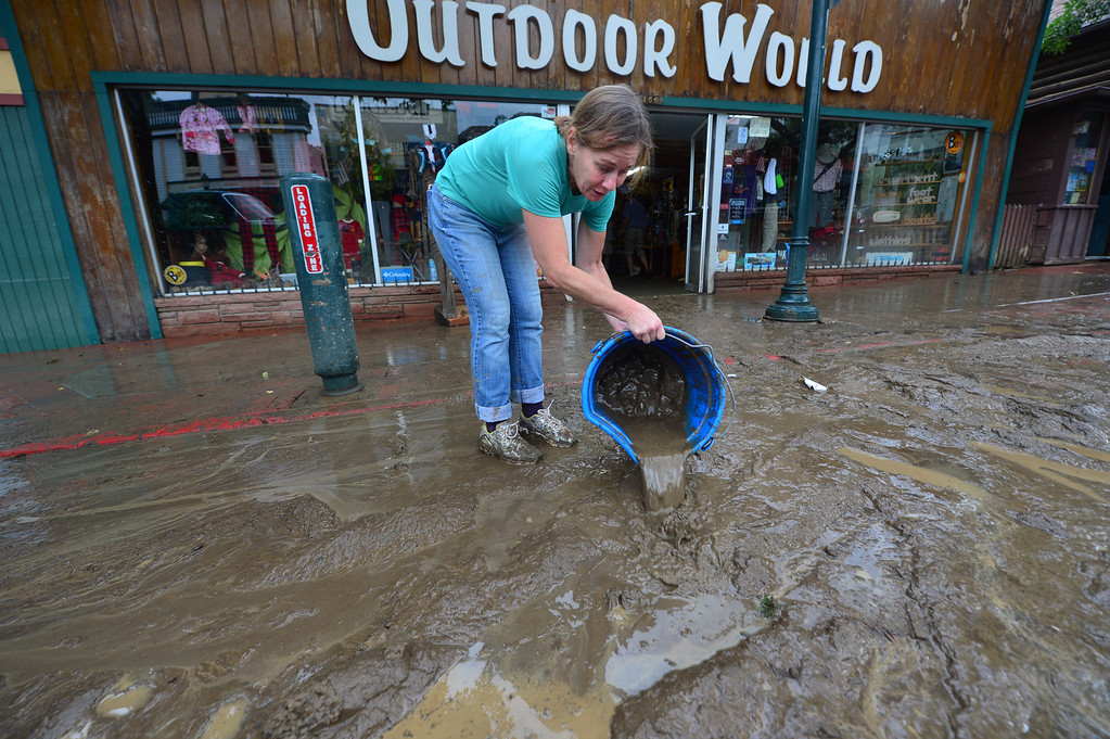 . Friends and volunteers begin removing mud from Outdoor World on Saturday, September 14, 2013. Clean up began almost as soon as rain stopped falling, as Estes Park residents and businesses remover mud and debris. Walt Hester/Estes Park Trail-Gazette