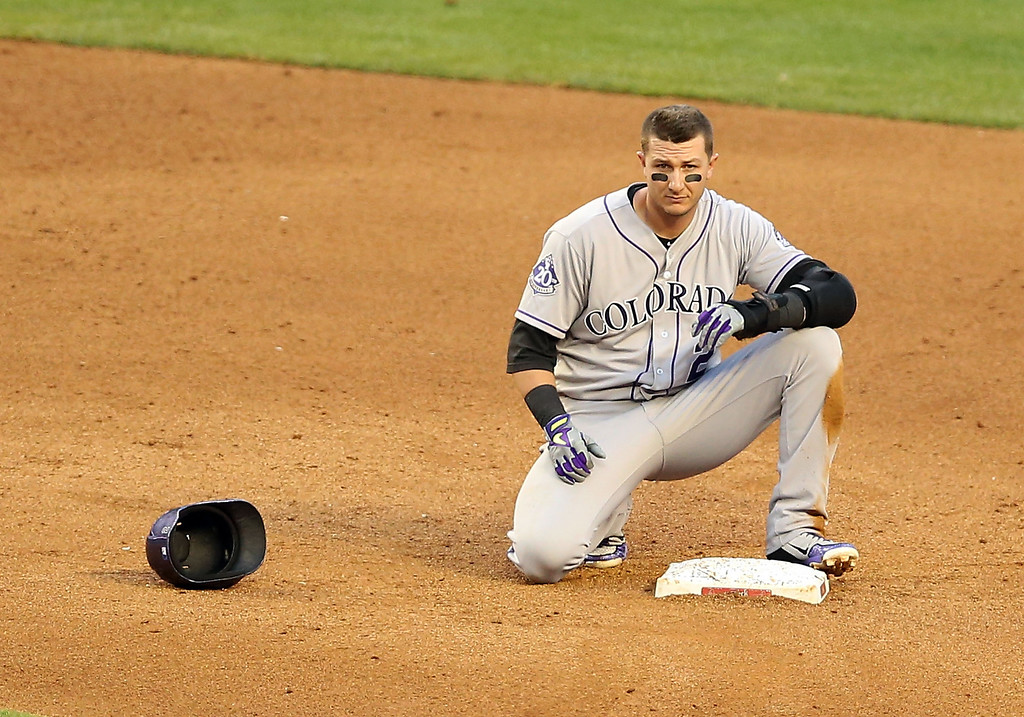 . PHOENIX, AZ - APRIL 27:  Troy Tulowitzki #2 of the Colorado Rockies reacts after being forced out at second base during the fifth inning of the MLB game against the Arizona Diamondbacks at Chase Field on April 27, 2013 in Phoenix, Arizona.  (Photo by Christian Petersen/Getty Images)