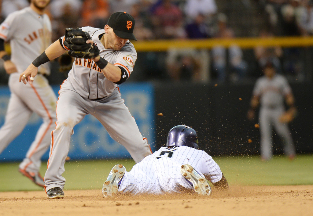 . DENVER, CO. - June 28: Carlos Gonzalez of Colorado Rockies (5) succeed steal 2nd base from Marco Scutaro (19) of San Francisco Giants in the 4th inning of the game at Coors Field. Denver, Colorado. June 28, 2013. Colorado won 4-1. (Photo By Hyoung Chang/The Denver Post)