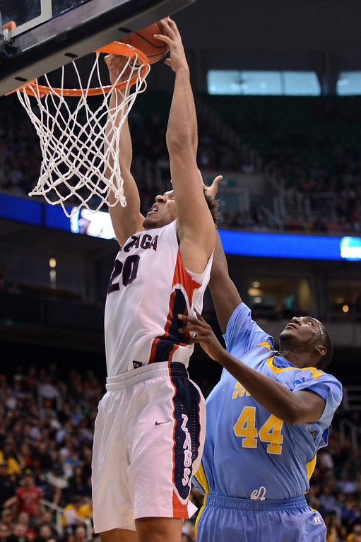 . SALT LAKE CITY, UT - MARCH 21:  Elias Harris #20 of the Gonzaga Bulldogs dunks the ball in front of Javan Mitchell #44 of the Southern University Jaguars in the first half during the second round of the 2013 NCAA Men\'s Basketball Tournament at EnergySolutions Arena on March 21, 2013 in Salt Lake City, Utah.  (Photo by Harry How/Getty Images)