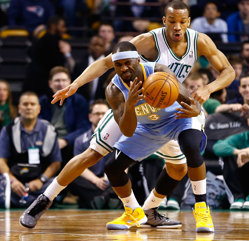 . BOSTON, MA - FEBRUARY 10: Ty Lawson #3 of the Denver Nuggets is fouled by Avery Bradley #0 of the Boston Celtics during the game on February 10, 2013 at TD Garden in Boston, Massachusetts.  (Photo by Jared Wickerham/Getty Images)