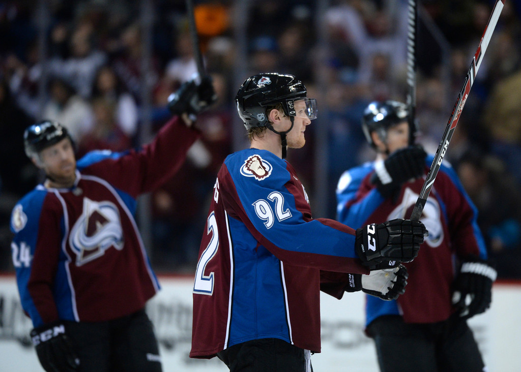 . DENVER, CO. - JANUARY 04:  Winger Gabriel Landeskog celebrated at mid-ice with the team following the win. The Colorado Avalanche defeated the San Jose Sharks 4-3 at the Pepsi Center Saturday afternoon, January 4, 2014. Photo By Karl Gehring/The Denver Post