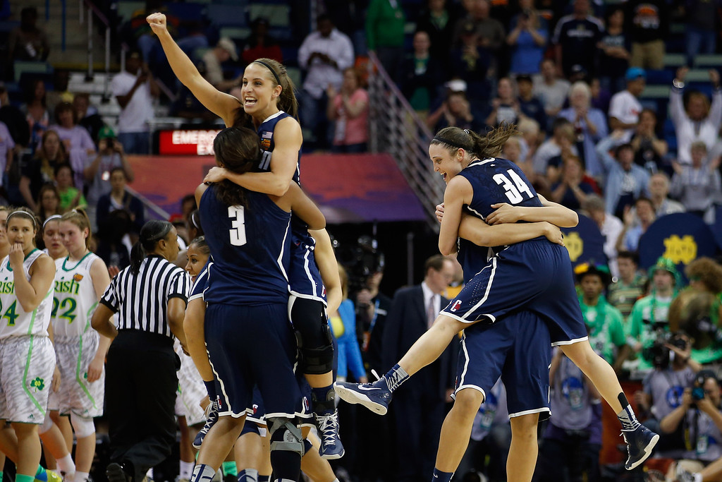 . Members of the Connecticut Huskies celebrate after defeating the Notre Dame Fighting Irish 83-65 during the National Semifinal game of the 2013 NCAA Division I Women\'s Basketball Championship at the New Orleans Arena on April 7, 2013 in New Orleans, Louisiana.  (Photo by Chris Graythen/Getty Images)