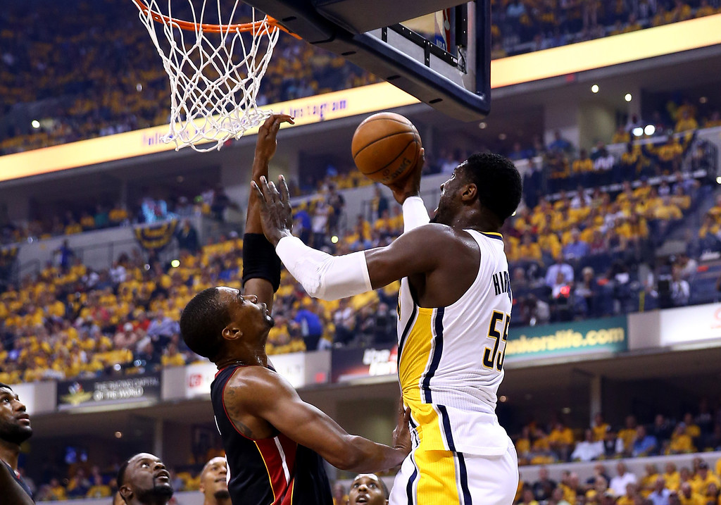 . INDIANAPOLIS, IN - MAY 28:  Roy Hibbert #55 of the Indiana Pacers goes to the basket as Chris Bosh #1 of the Miami Heat defends during Game Five of the Eastern Conference Finals of the 2014 NBA Playoffs at Bankers Life Fieldhouse on May 28, 2014 in Indianapolis, Indiana.  (Photo by Andy Lyons/Getty Images)