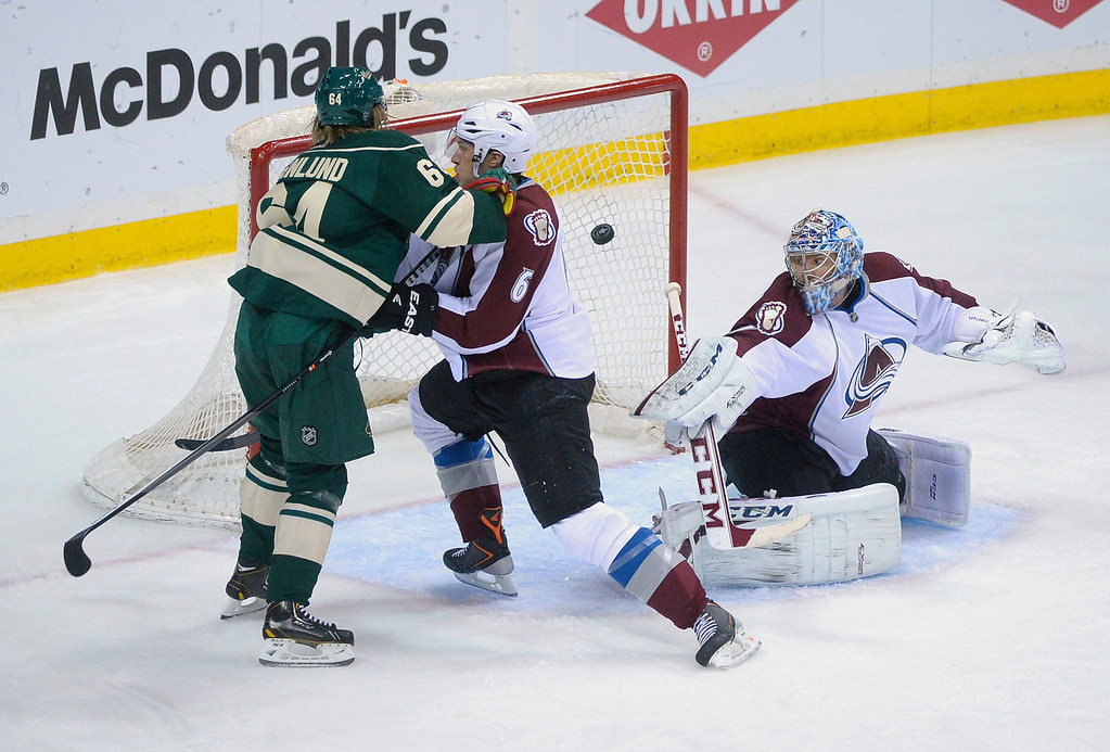 . Colorado defenseman Erik Johnson (6) pushed Wild center Mikael Granlund (64) away from the net at Wild defenseman Jared Spurgeon (not pictured) put the puck past Semyon Varlamov (1) in the first period.  (Photo by Karl Gehring/The Denver Post)