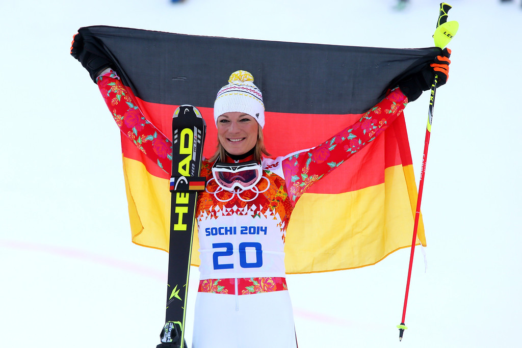 . Gold medalist Maria Hoefl-Riesch of Germany celebrates during the flower ceremony for the Alpine Skiing Women\'s Super Combined on day 3 of the Sochi 2014 Winter Olympics at Rosa Khutor Alpine Center on February 10, 2014 in Sochi, Russia.  (Photo by Alexander Hassenstein/Getty Images)