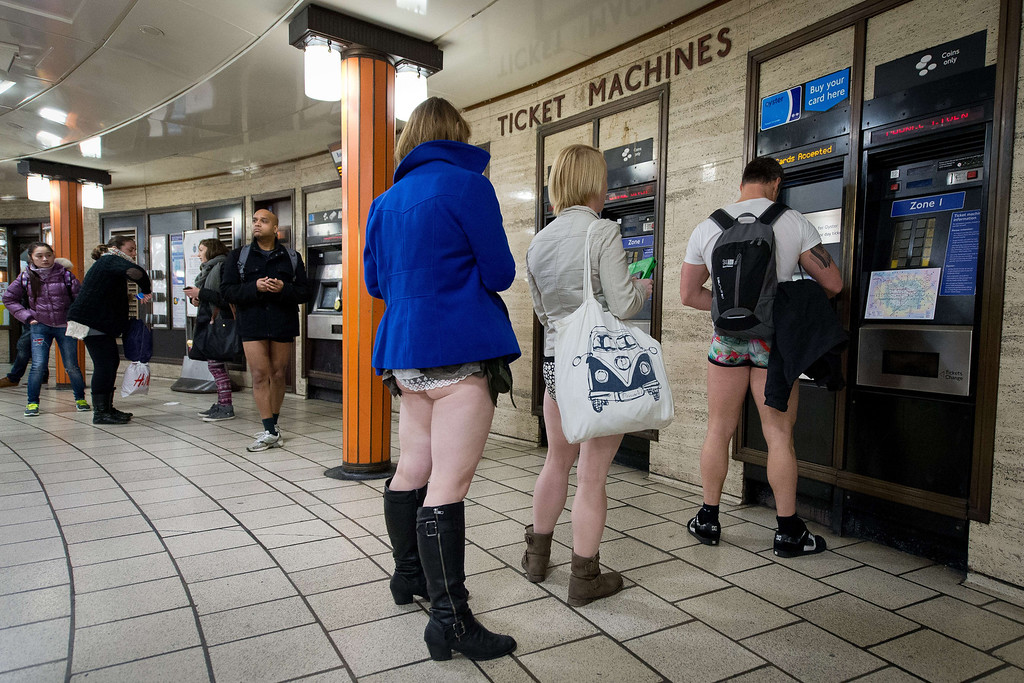 ". Participants in the13th annual International ""No Pants Subway Ride\"" queue for tickets at a London underground station in London, on January 12, 2014. Starting in 2002 with only seven participants, the day is now marked in over 60 cities around the world.  The idea behind \""No Pants\"" is that random passengers board a subway car at separate stops in the middle of winter, without wearing trousers. The participants wear all of the usual winter clothing on their top half such as hats, scarves and gloves and do not acknowledge each other\'s similar state of undress.  LEON NEAL/AFP/Getty Images"