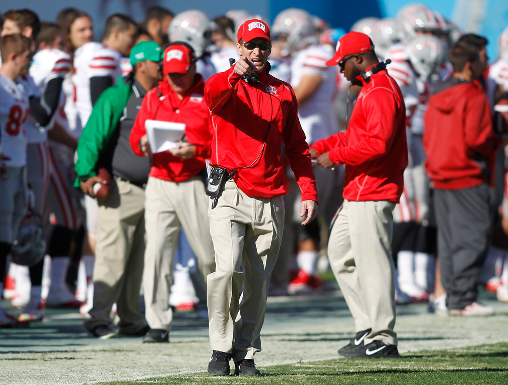 . UNLV head coach Bobby Hauck directs his team from the sideline during the first half of the Heart of Dallas NCAA college football game against North Texas, Wednesday, Jan. 1, 2014, in Dallas. (AP Photo/Mike Stone)