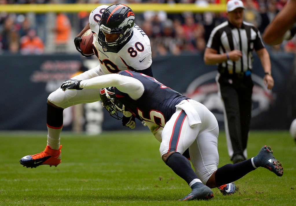 . Tight end Julius Thomas #80 of the Denver Broncos is stopped short of the first down as the Broncos loose the ball to the Houston Texans on downs at Reliant Stadium December 22, 2013 Houston, Texas. (Photo By Joe Amon/The Denver Post)