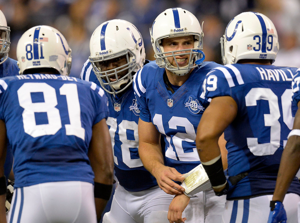 . Indianapolis Colts quarterback Andrew Luck (12) calls the play in the huddle during the third quarter October 20, 2013 at Lucas Oil Field. Photo by John Leyba/The Denver Post)