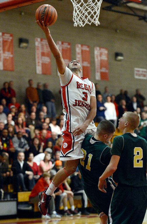 . LITTLETON, CO. - JANUARY 29: Regis Josh Perkins (3) goes up for a shot and draws the blocking foul on Mountain Vista Mitch Carter (21) during their game January 29, 2013 at Regis.  (Photo By John Leyba / The Denver Post)