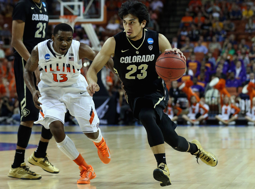 . AUSTIN, TX - MARCH 22:  Sabatino Chen #23 of the Colorado Buffaloes dribbles past Tracy Abrams #13 of the Illinois Fighting Illini during the second round of the 2013 NCAA Men\'s Basketball Tournament at The Frank Erwin Center on March 22, 2013 in Austin, Texas.  (Photo by Stephen Dunn/Getty Images)
