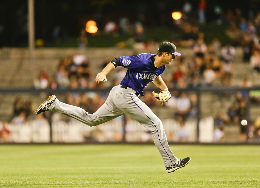 . Colorado Rockies second baseman DJ LeMahieu can\'t catch up with a bloop single by San Diego Padres\' Will Venable in the sixth inning of a baseball game in San Diego, Monday, July 8, 2013. (AP Photo/Lenny Ignelzi)