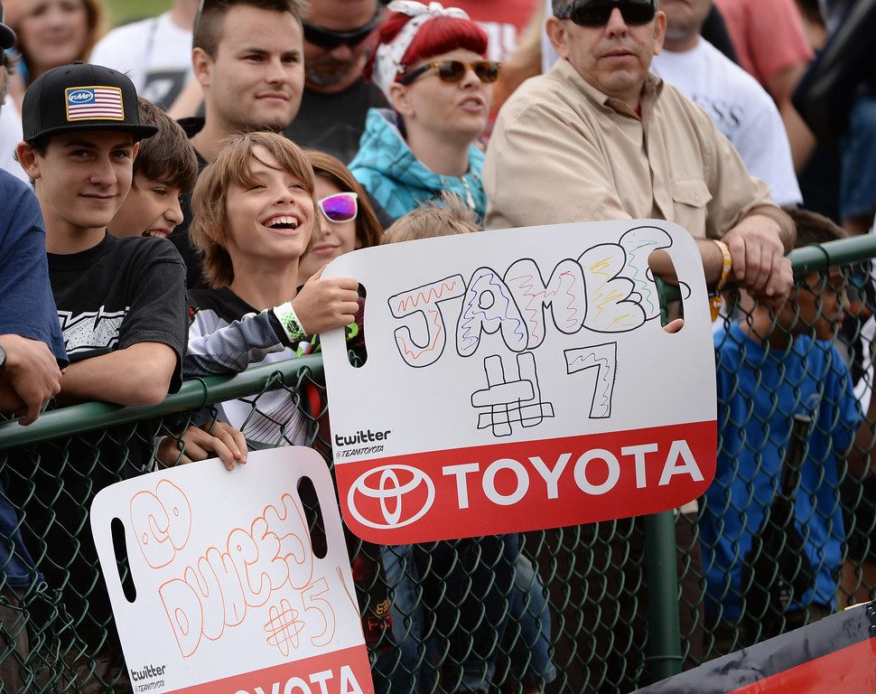. Fans cheer the racers during 450 Class Moto #1 of the third round of the Lucas Oil Pro Motocross Championship at Thunder Valley MX Park. Lakewood, Colorado. June 07. 2014. (Photo by Hyoung Chang/The Denver Post)